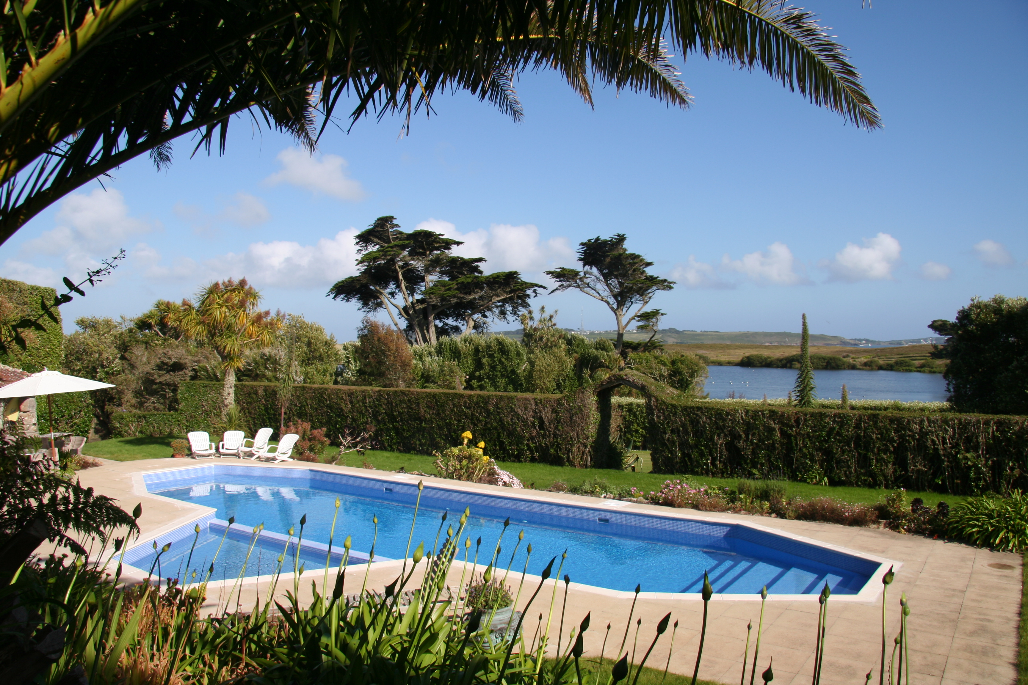 Experts in swimming pool design build millaquia for Outdoor swimming pool design uk